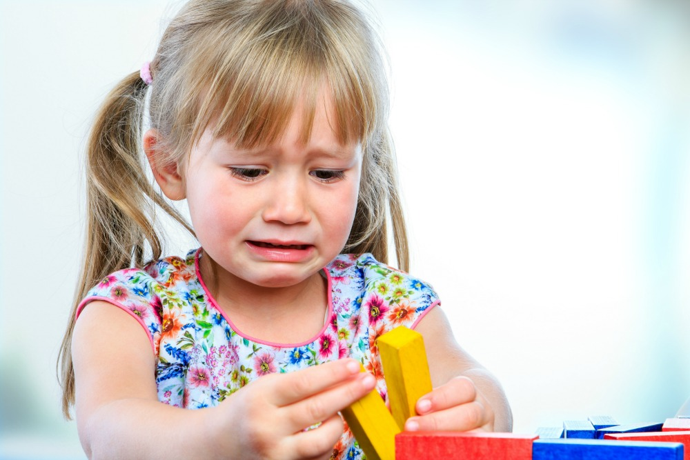 What would you tell this little girl? That she's rubbish at building, good at sorting colours, or something else?